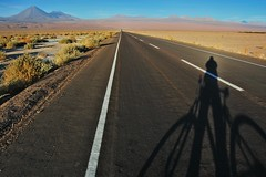 Biking alone for hundreds of miles (XianMD) Tags: chile sunset shadow cactus selfportrait southamerica water bike bicycle danger volcano travels highway alone desert dry biking atacama solitary sanpedro lptransportation driestpalceonearth