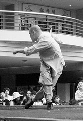 Shaolin Wushu Demonstration (shaire productions) Tags: sanfrancisco california street city portrait people urban man motion male guy art festival asian demo oakland town photo movement community chinatown shot action candid stage traditional chinese performance arts culture style monk martialarts fair exhibit parade celebration demonstration event photograph kungfu gathering onstage faire sfbayarea annual bazaar wushu tradition fest showcase shaolin cultural stance streetfest oaklandchinatown yearly