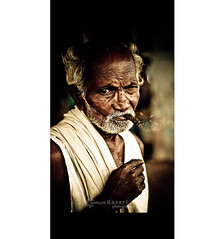 Smoking out! (SiddharthDasari) Tags: life old portrait india lines canon 50mm grey intense dangerous eyes risk expression indian smoke oldman cigar smoking health processing wisdom andhra pradesh lightroom vizag beedi sutta visakhapatnam chutta injurios canoneos1000d siddharthdasari poornamarket