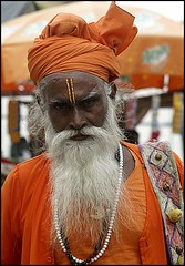 proud and vigorous Sadhu (maios) Tags: travel portrait orange india man color face proud beard photo intense eyes flickr foto photographer monk agra stare turban fotografia hinduism sadhu vigorous manikis tilak maios iosif hindus heliography