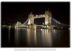 Tower Bridge (Muzammil (Moz)) Tags: uk longexposure london beautiful towerbridge landscape nightshot canon20d westminister tamron1750 muzammilhussain peregrino27newvision