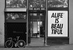The Capitalists think so too. (gracemlau) Tags: life street urban blackandwhite bw white black streets bicycle vancouver store downtown britishcolumbia philosophy boutique storefront gastown lifeisbeautiful alife thealife alifeinc