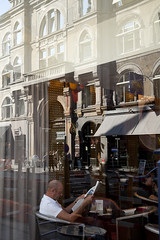 Man reading newspaper in cafe window, Copenhagen, Denmark (Rob Casey) Tags: travel distortion man reflection male tourism window glass architecture canon buildings copenhagen denmark person photography reading cafe sitting exterior newspapers coffeeshop dk scandinavia oneperson destinations colorimage robcasey
