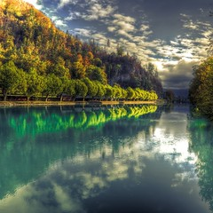 Swiss Autumn (toffiloff) Tags: travel bridge autumn trees lake alps reflection fall water clouds forest canon river square schweiz switzerland canal october europe suisse riverside railway mirrorimage svizzera 2009 hdr squarecrop interlaken sveits cpl hst greenwater 500x500 scweiz llens photomatix interlakenost circularpolarizingfilter canonef24105mmf40lisusm canoneos5dmarkii bwuvfilter hoyapro1cplfilter
