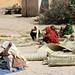 Keren - women selling woven mats at the wood market