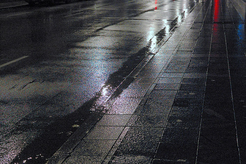Downtown Saint Louis, Missouri, USA - pavement at night in the rain