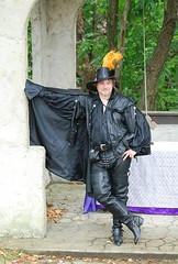 Renfair leather guy in tall boots (RenfairJim) Tags: costumes leather pittsburgh capes renfair renfest doublet garb blackboots cavalierhat harnessbootstraps