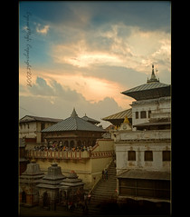 Pashupati Temple... Deopatan Nepal (CyrusMafi) Tags: world street nepal boy sunset sky man color clouds bells temple god labor medal hunger internation hindu katmandu geographic journalism ih excellence natinal hindugods anawesomeshot aplusphoto photographyphoto workingboy amazingshots ysplix orients overtheexcellence theperfectphotographer goldstaraward qualitypixels flickrlovers paverty photoartbloggroup moodcreations cyrusmafi gragondaggeraword photojournalistgoldmedalwinner tempelofshiva pashpatitemple