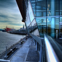 Vancouver Convention Centre (ecstaticist) Tags: ocean city travel blue light sea sky urban cloud postprocessed reflection water glass metal vancouver photoshop canon marine waterfront pacific centre pillar cement tint center beam walkway commute convention environment rim shipping hdr causeway topaz adjust ocaen photomatix g10 anglu
