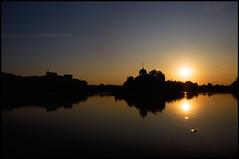 Prague #26: Sunrise (Kenneth McNeil) Tags: morning summer reflection sunrise reflections golden prague earlymorning praha symmetry spire czechrepublic 2009 vltava moldau goldensunrise goldenhue kennethmcneil summer2009 sunriseinprague