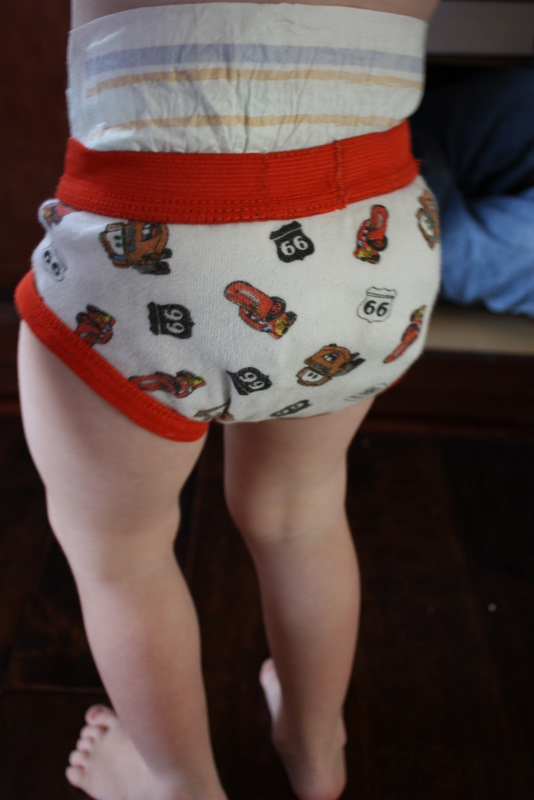 wearing a funny face and wearing undies over my diaper