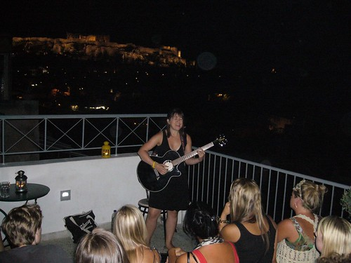 And she is in front of the Acropolis