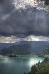 God's light looking for a church (Bas Lammers) Tags: lake church water canon slovenia bled soe hdr photomatix 50d abigfave anawesomeshot flickrdiamond vosplusbellesphotos artofimages bestcapturesaoi