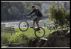 A boy and his bike (Eyesplash - There is a change in the air.) Tags: wood trees boy man unguessed young logs benches wheelie rockman kenda discbrakes gwv noseat trickbike kortz eyesplashimages