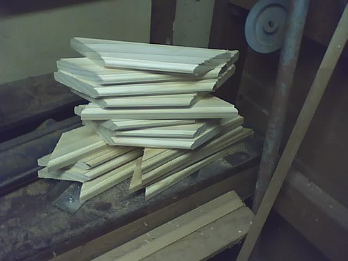 A stack of frame pieces, ready to debur, glue, and press.