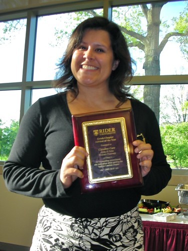 Claudine grins after winning the Chapter Advisor of the Year Award