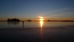 P1030540 (Remko van Dokkum) Tags: sunset sun ice set zonsondergang iceskating skating zon schaatsen schaats ondergang natuurijs uitdam