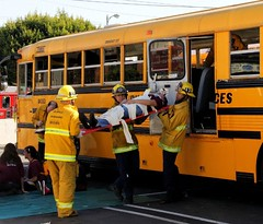 Los Angeles Firefighters extricate students from a 2 school bus collision. © Photo by John Conkle. Click to view more...