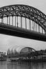 Tyne Bridge framing The Sage (Leo Reynolds) Tags: bridge bw photoshop canon eos iso400 28mm f95 30d 0006sec hpexif leol30random groupbw groupblackwhite groupsepiabw groupblackwhitepics xleol30x xxx2009xxx xratio2x3x
