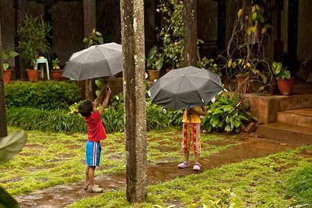 Chitra Aiyer - Kids playing in the rain, Ammadi homestay