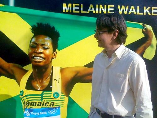 Hank Dittmar with mural of Olympic gold medalist Melanie Walker, Rose Town (courtesy of Hank Dittmar)