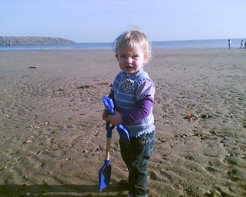 R on the beach