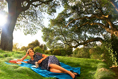 Daydreaming 1 (sonya_revell) Tags: woman sunlight tree nature outdoors reading picnic surreal ivy books blanket greengrass son