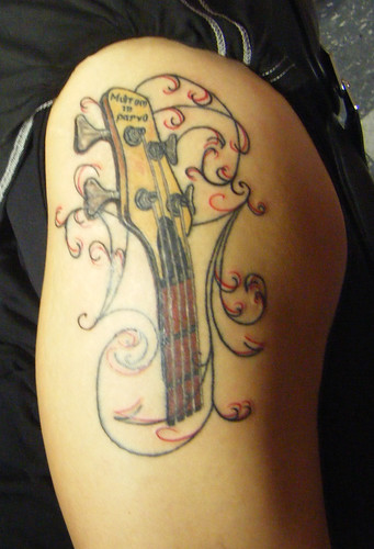 "This is my Ibenz bass guitar tattoo. The latin phrase is ""Multum in parvo"""
