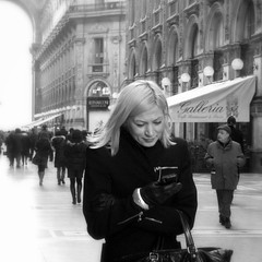 What Is This Thing Called Love (Donato Buccella / sibemolle) Tags: street portrait blackandwhite bw woman milan girl smile donna candid streetphotography ragazza galleriavittorioemanuele milani quandoricevereunsmsdgioia fotografiastradale