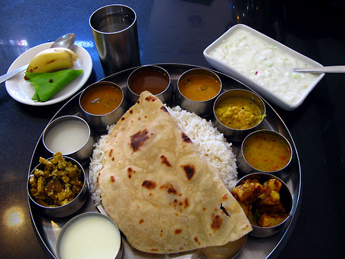 Thali, or set meal. It is usually all you can eat, usually eaten by hand, and usually spicy. What made this one special is the addition of extra cups of ingredients.