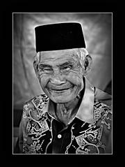 portrait of people 1 ({isa}) Tags: portrait people bw monochrome malaysian wajah songkok ranau d90 sabahan landbelowthewind nikond90