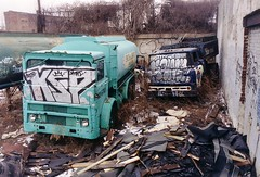 North Philadelphia, 2003 (Hear It Snap) Tags: graffiti garbage northphiladelphia coaltruck roofingmaterials junktrucks abandonedtrucks fordcseries mackmb fueloiltanker