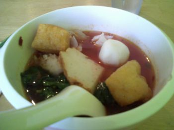 Bua Siam Broad Rice Noodle Soup with fish ball squid and red sauce