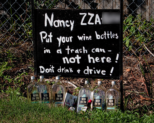 Nancy [license plate number] - Put your wine bottles in a trash can - not here! Don't drink + drive!