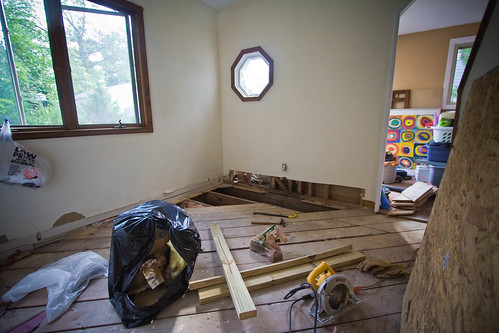 Ripped out flooring, sub floor, insulation, and a good foot of the wall!
