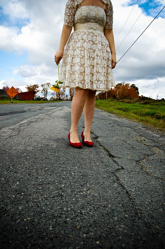 bride in short lace dress and red shoes