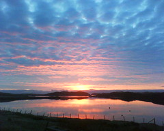 Red sky in the morning.... (cmcrossbost) Tags: blue sea sky reflection silhouette clouds sunrise fence hills isleoflewis hebrides sealoch lochcrossbost
