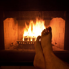 Day 165/365: Happy New Year (Styggiti) Tags: winter portrait holiday selfportrait brick feet me self fire eos fireplace toes december warmth rob heat newyearseve 365 2008 365days expressionsofself eox 165365