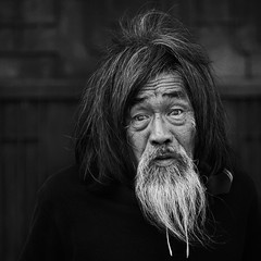 Portrait of Mystery... (wazari) Tags: life china street old portrait blackandwhite monochrome look beard photography mono model eyes asia chinatown mood photoshoot emotion expression candid naturallight streetlife oldman monotone historic portraiture malaysia wise photowalk historical moment melaka asean malacca wiseman vagabond catchlight jonkerstreet historicalcity jonkerwalk janggut bersejarah orangtua hitamputih wazari wazariwazir