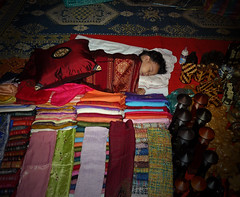 Please be quiet at the night market (Bn) Tags: crafts nightmarket quilts textiles laos handicrafts luangprabang sleepingchild vendors notforsale nachtmarkt ancientcapital marketvendors sisavangvong earthasia slenteren clothingandcarving mainwalkingstreet touristcrowds laossilkscarves redcanvascanopycovers littleboysleepingatmarket sleepinglittleboy fromdusktill10pm hmongdecorativedesigns pleasebequietatnightmarket littlesweetprince