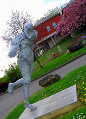 without face. (Pendore) Tags: centrehospitalierdelaval france entrance statue sculpture grass green red bloomedtree canong7 pendore