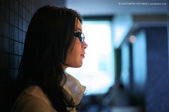 Tanya (Konstantin Sutyagin) Tags: blue portrait people woman blur cold cute girl beautiful beauty face look smart fashion silhouette horizontal closeup female dark hair asian nose person one glasses photo cool model long pretty slim looking adult bokeh interior profile young style calm indoors attractive inside concept copyspace brunette lovely elegant ethnic tone confident stylish eyewear