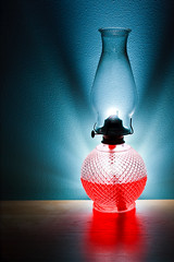 Lamp ablaze (mehampson) Tags: blue light red lamp canon glow halo oil glowing aura oillamp 40d canon40d