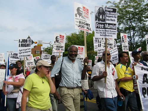 Abayomi Azikiwe, editor of the Pan-African News Wire, covering the March for Jobs in Pittsburgh on September 20, 2009. The event was held in the historic 'Hill District' and started off a week of protests surrounding the G20. (Photo: Alan Pollock) by Pan-African News Wire File Photos
