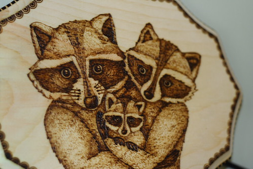 Woodburned raccoons