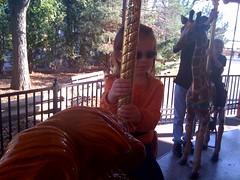 cady zoo 11.07.09 (genuine_youth) Tags: november sunglasses happy zoo sunny carousel littlekid cutetoddler zoocarousel