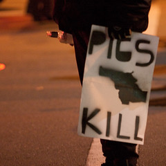 Protestor Holds Bottle, Oakland Riots (Thomas Hawk) Tags: california usa delete10 delete9 delete5 delete2 oakland riot stencil kill unitedstates fav50 delete6 10 delete7 unitedstatesofamerica protest bart save3 delete8 delete3 save7 delete delete4 save save2 fav20 save4 pigs eastbay save5 save6 fav30 riots downtownoakland fav10 fav25 bartpolice fav40 fav60 superfaves fav80 fav70 oscargrant oaklandriot oaklandriot2009 oaklandriots2009 oscargrantriots oaklandriots