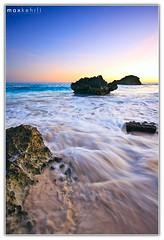 A Waving Wave (Max Kehrli) Tags: ocean blue sunset sea color colour beach water canon bay coast long exposure december tide wave atlantic limestone bermuda horseshoe 1022 5962 40d