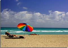 A perfect day at the beach in South Florida and me without my bikini...lol { Explored } (canmom ( Carrie )) Tags: ocean blue sea sky sun colors clouds landscape sand florida miami explore unbrella hollywoodbeach explored mywinners theunforgettablepictures theperfectphotographer goldstaraward