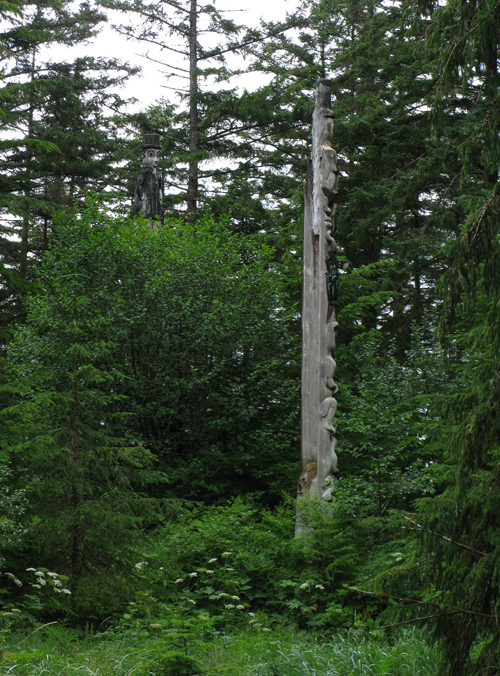 two totems seen from the trail to Kasaan Totem Park, Alaska